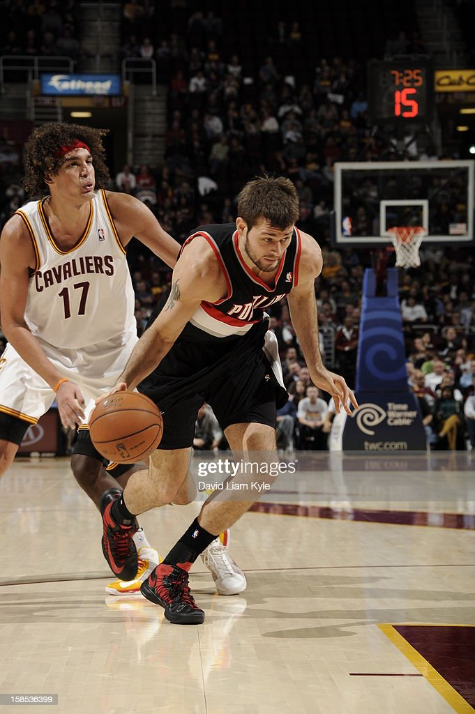 <a gi-track='captionPersonalityLinkClicked' href=/galleries/search?phrase=Joel+Freeland&family=editorial&specificpeople=757235 ng-click='$event.stopPropagation()'>Joel Freeland</a> #19 of the Portland Trail Blazers drives to the basket around Anderson Varejao #17 of the Cleveland Cavaliers at The Quicken Loans Arena on December 1, 2012 in Cleveland, Ohio.
