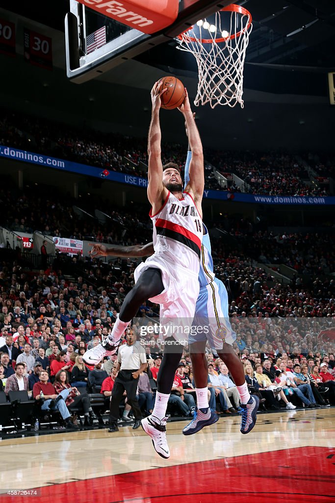Joel Freeland of the Portland Trail Blazers dunks against the Denver Nuggets on November 9 2014 at the Moda Center Arena in Portland Oregon NOTE TO...