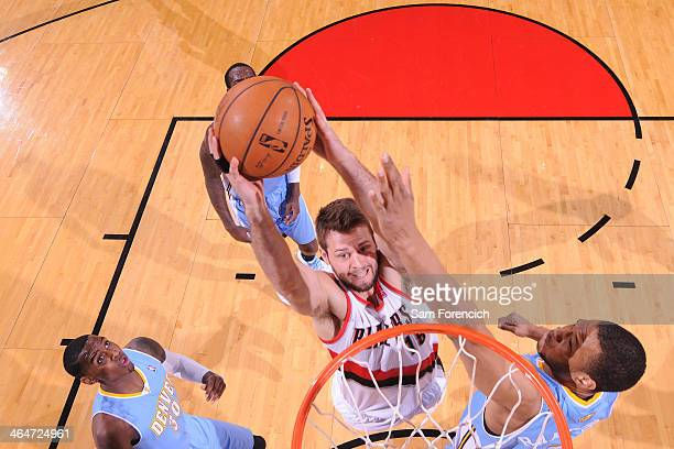 Joel Freeland of the Portland Trail Blazers dunks the ball against the Denver Nuggets on January 23 2014 at the Moda Center Arena in Portland Oregon...
