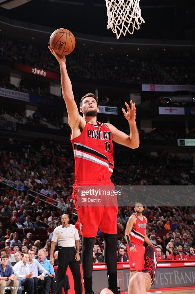 Joel Freeland of the Portland Trail Blazers goes for the layup against the Houston Rockets during the game on December 22 2014 at Toyota Center in...