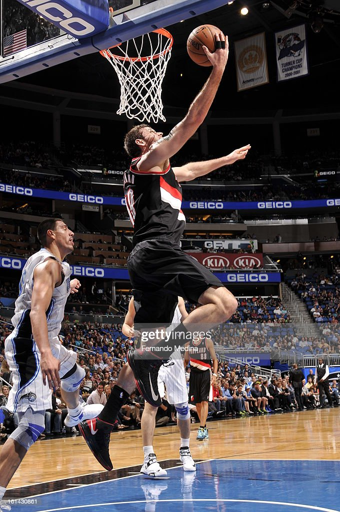 Joel Freeland #19 of the Portland Trail Blazers goes in for a reverse layup against Gustavo Ayon #19 of the Orlando Magic on February 10, 2013 at Amway Center in Orlando, Florida.