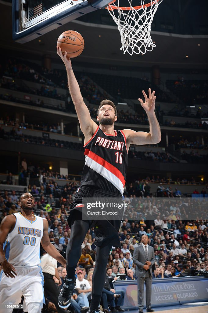 Joel Freeland of the Portland Trail Blazers goes to the basket against the Denver Nuggets on December 2 2014 at the Pepsi Center in Denver Colorado...