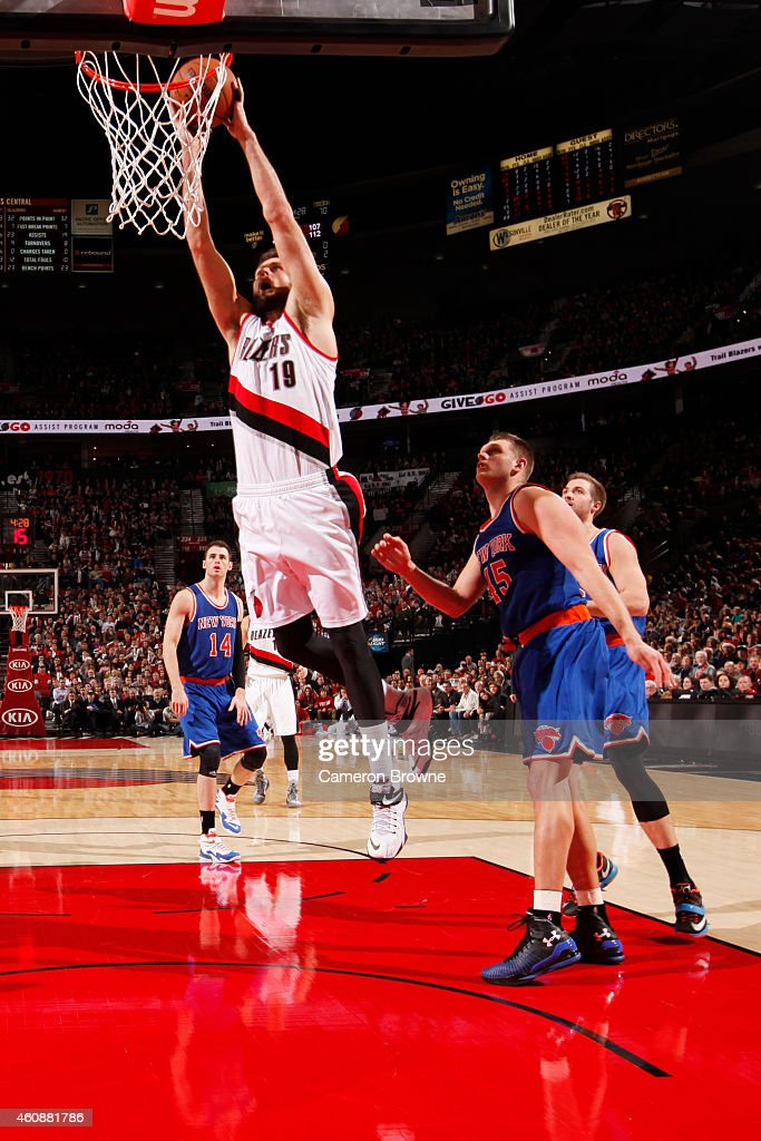 Joel Freeland of the Portland Trail Blazers goes to the basket against the New York Knicks on December 328 2014 at the Moda Center in Portland Oregon...