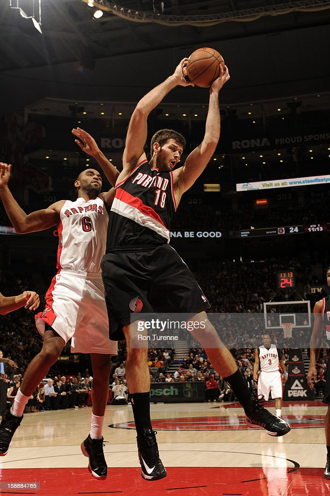 Joel Freeland #18 of the Portland Trail blazers grabs a rebound against the Toronto Raptors during the game on January 2, 2013 at the Air Canada Centre in Toronto, Ontario, Canada.
