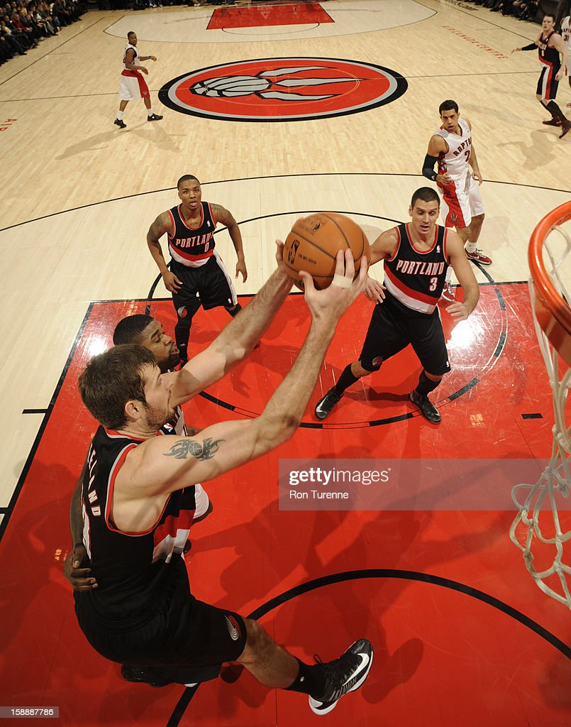 <a gi-track='captionPersonalityLinkClicked' href=/galleries/search?phrase=Joel+Freeland&family=editorial&specificpeople=757235 ng-click='$event.stopPropagation()'>Joel Freeland</a> #19 of the Portland Trail Blazers grabs a rebound against the Toronto Raptors during the game on January 2, 2013 at the Air Canada Centre in Toronto, Ontario, Canada.
