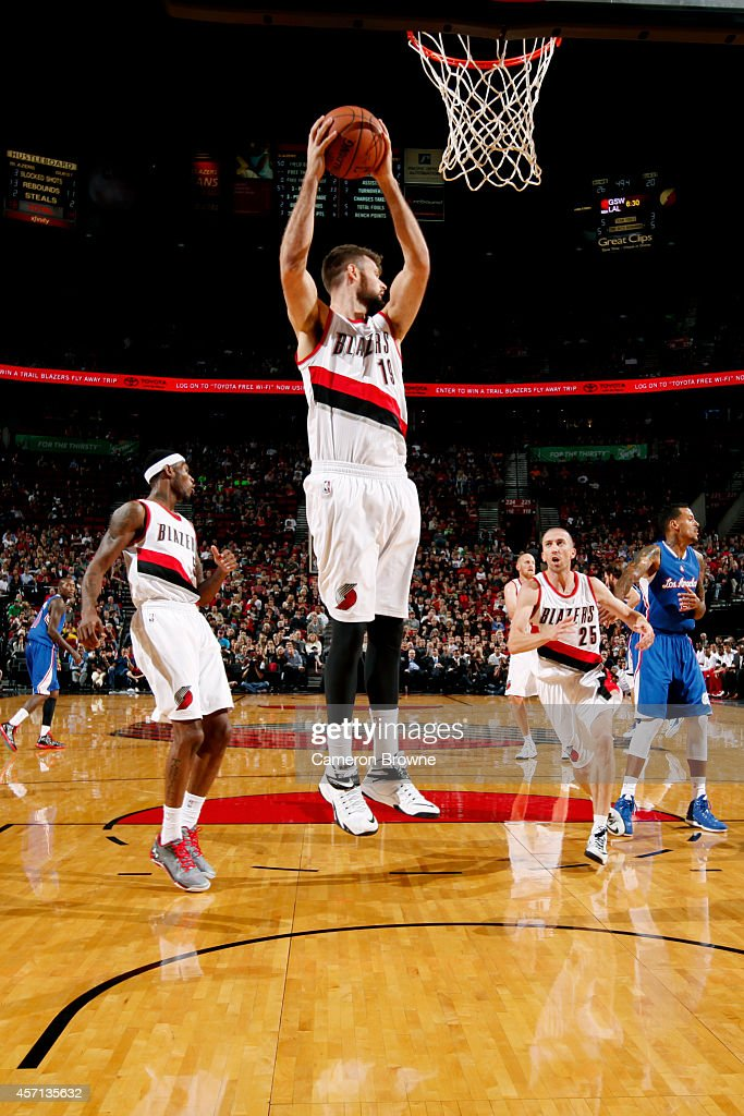 Joel Freeland of the Portland Trail Blazers grabs a rebound against the Los Angeles Clippers on October 12 2014 at the Moda Center Arena in Portland...