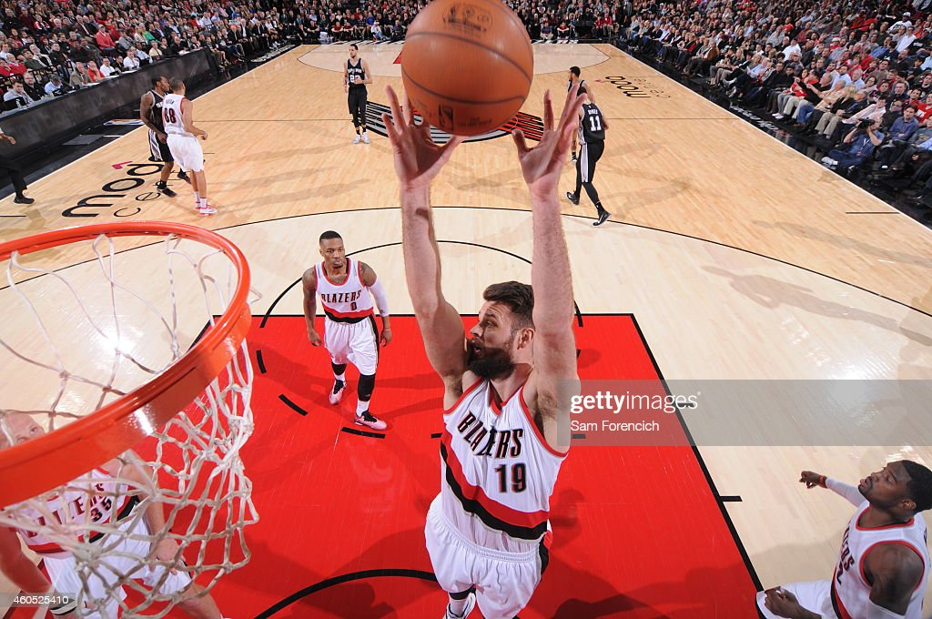 Joel Freeland of the Portland Trail Blazers grabs a rebound against the San Antonio Spurs on December 15 2014 at the Moda Center in Portland Oregon...