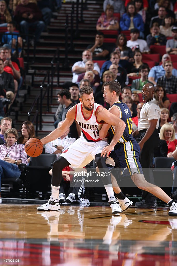Joel Freeland of the Portland Trail Blazers is defended by Steve Novak of the Utah Jazz on October 9 2014 at the Moda Center Arena in Portland Oregon...