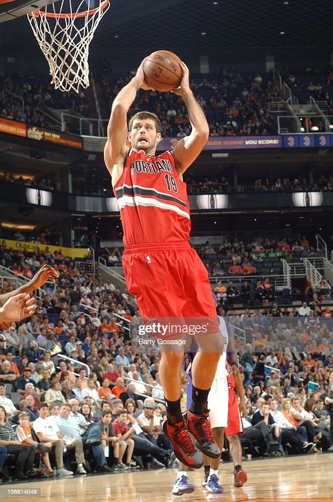 <a gi-track='captionPersonalityLinkClicked' href=/galleries/search?phrase=Joel+Freeland&family=editorial&specificpeople=757235 ng-click='$event.stopPropagation()'>Joel Freeland</a> #19 of the Portland Trail Blazers pulls down a rebound against the Phoenix Suns on November 21, 2012 at U.S. Airways Center in Phoenix, Arizona.