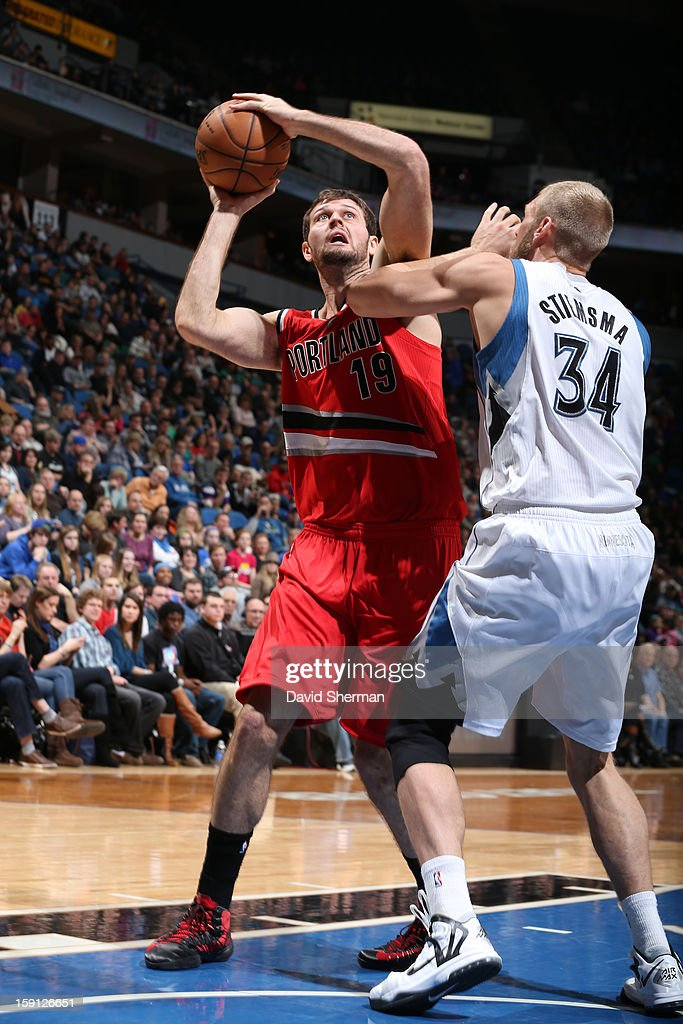 <a gi-track='captionPersonalityLinkClicked' href=/galleries/search?phrase=Joel+Freeland&family=editorial&specificpeople=757235 ng-click='$event.stopPropagation()'>Joel Freeland</a> #19 of the Portland Trail Blazers puts up a shot against the Minnesota Timberwolves on January 5, 2013 at Target Center in Minneapolis, Minnesota.