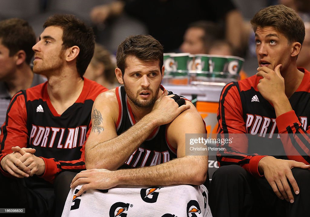 <a gi-track='captionPersonalityLinkClicked' href=/galleries/search?phrase=Joel+Freeland&family=editorial&specificpeople=757235 ng-click='$event.stopPropagation()'>Joel Freeland</a> #19 (C) of the Portland Trail Blazers reacts on the bench during the opening night NBA game against the Phoenix Suns at US Airways Center on October 30, 2013 in Phoenix, Arizona. The Suns defeated the Trail Blazers 104-91.