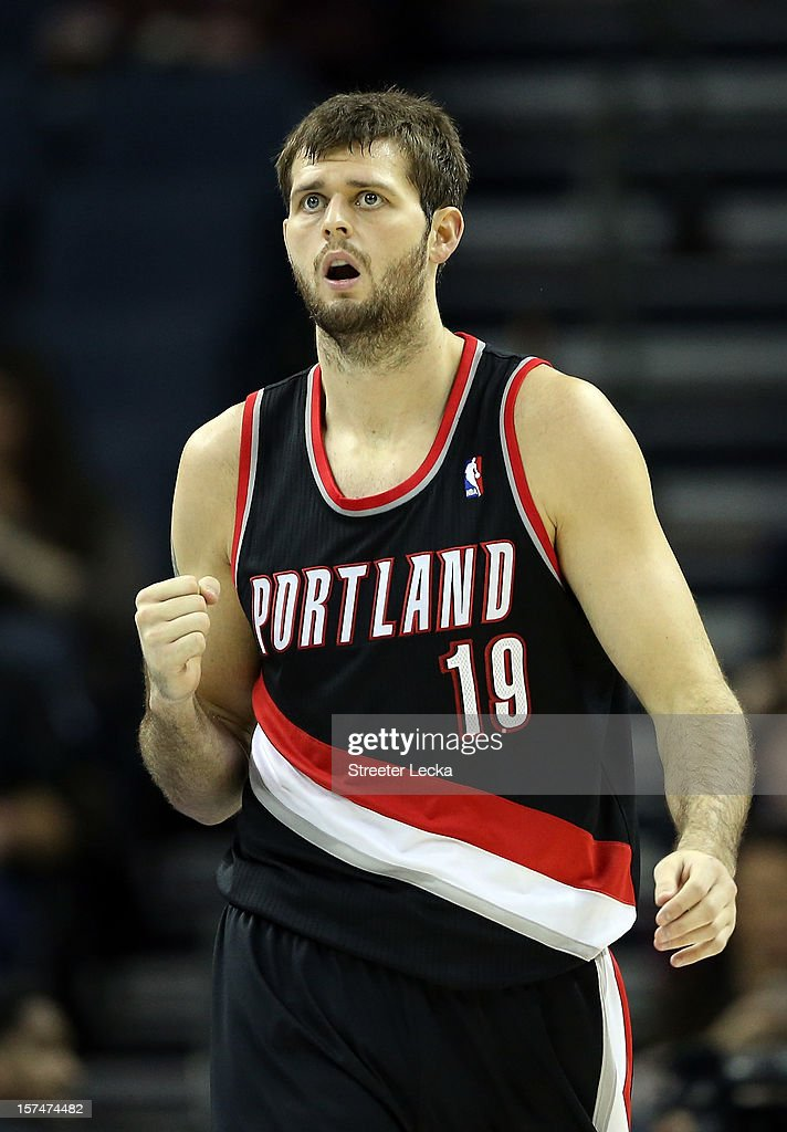 Joel Freeland of the Portland Trail Blazers reacts to a basket against the Charlotte Bobcats during their game at Time Warner Cable Arena on December...