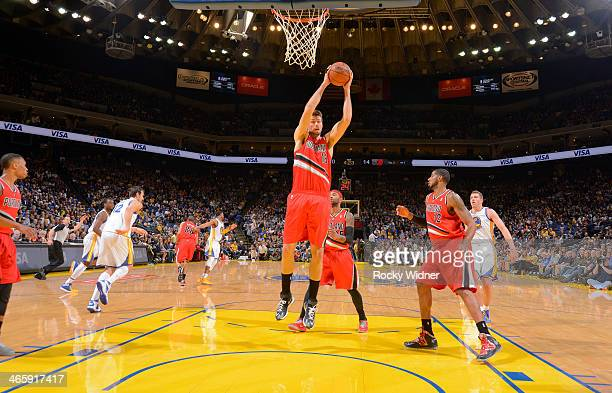 Joel Freeland of the Portland Trail Blazers rebounds against the Golden State Warriors on January 26 2014 at Oracle Arena in Oakland California NOTE...