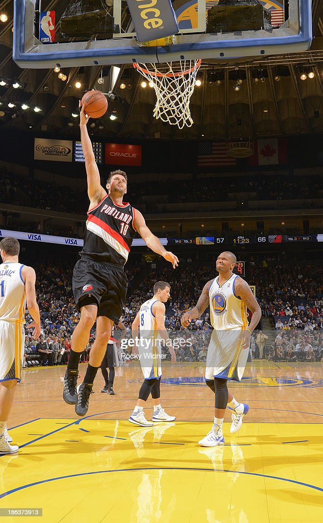<a gi-track='captionPersonalityLinkClicked' href=/galleries/search?phrase=Joel+Freeland&family=editorial&specificpeople=757235 ng-click='$event.stopPropagation()'>Joel Freeland</a> #19 of the Portland Trail Blazers shoots a layup against the Golden State Warriors on October 24, 2013 at Oracle Arena in Oakland, California.