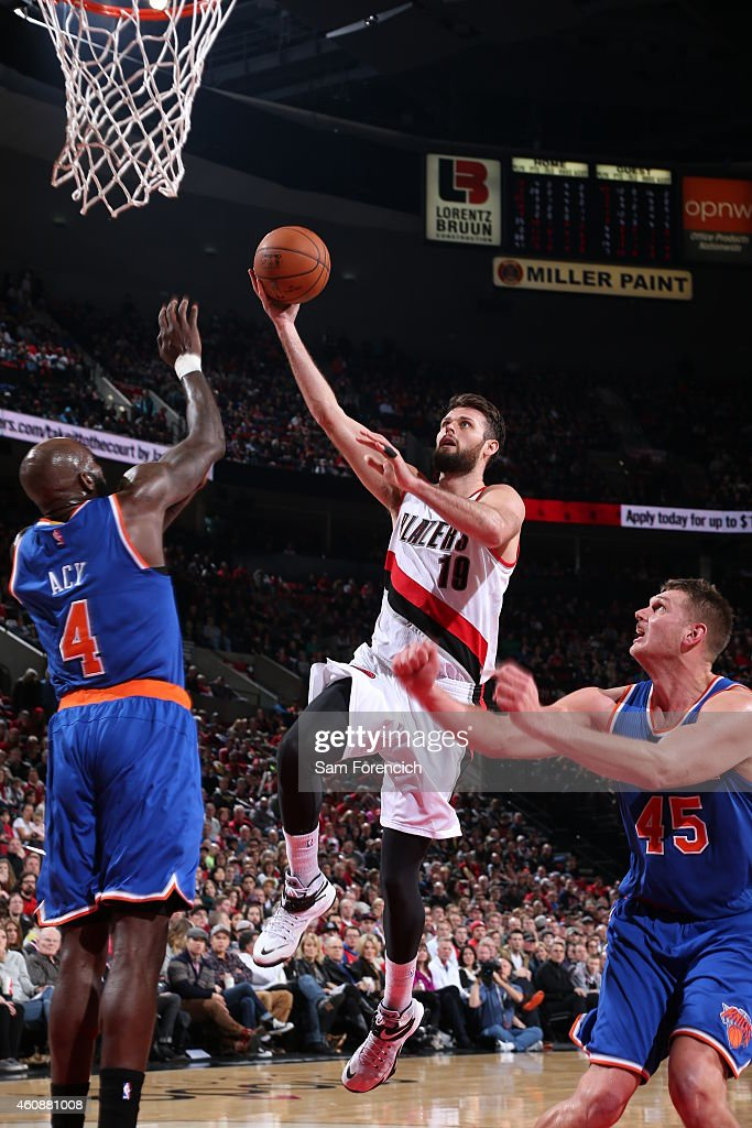 Joel Freeland of the Portland Trail Blazers shoots against Quincy Acy of the New York Knicks on December 28 2014 at the Moda Center in Portland...
