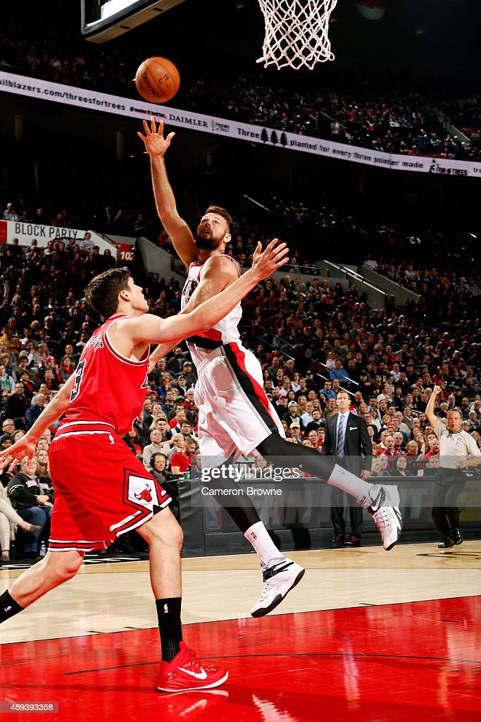 Joel Freeland of the Portland Trail Blazers shoots against the Chicago Bulls on November 21 2014 at the Moda Center Arena in Portland Oregon NOTE TO...