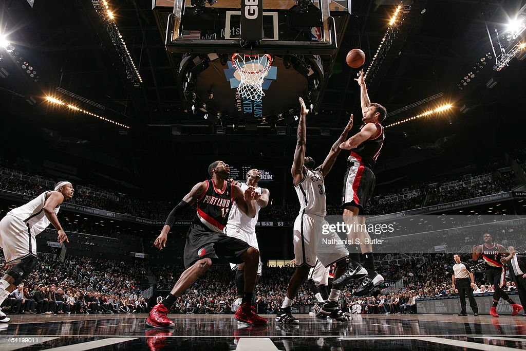 <a gi-track='captionPersonalityLinkClicked' href=/galleries/search?phrase=Joel+Freeland&family=editorial&specificpeople=757235 ng-click='$event.stopPropagation()'>Joel Freeland</a> #19 of the Portland Trail Blazers shoots against the Brooklyn Nets at Barclays Center on November 18, 2013 in the Brooklyn borough of New York City.