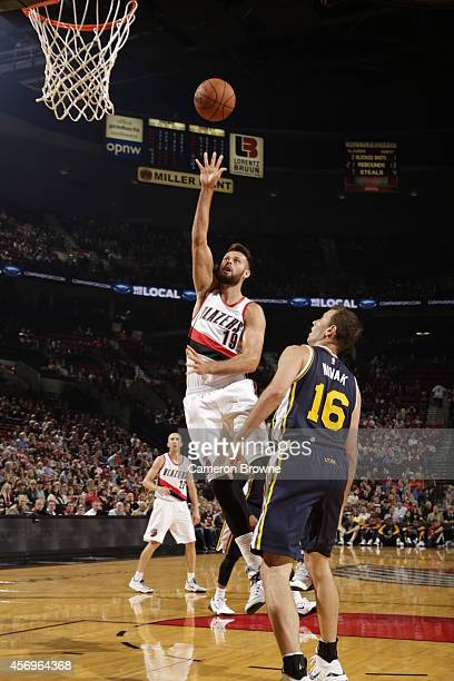 Joel Freeland of the Portland Trail Blazers shoots against the Utah Jazz on October 9 2014 at the Moda Center Arena in Portland Oregon NOTE TO USER...
