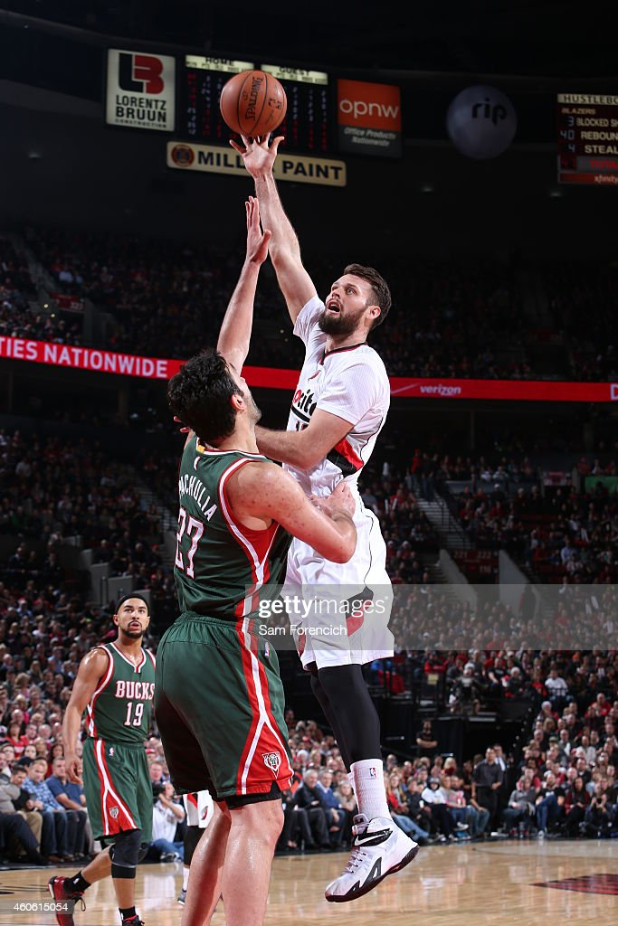 Joel Freeland of the Portland Trail Blazers shoots the ball against the Milwaukee Bucks during the game on December 17 2014 at the Moda Center in...