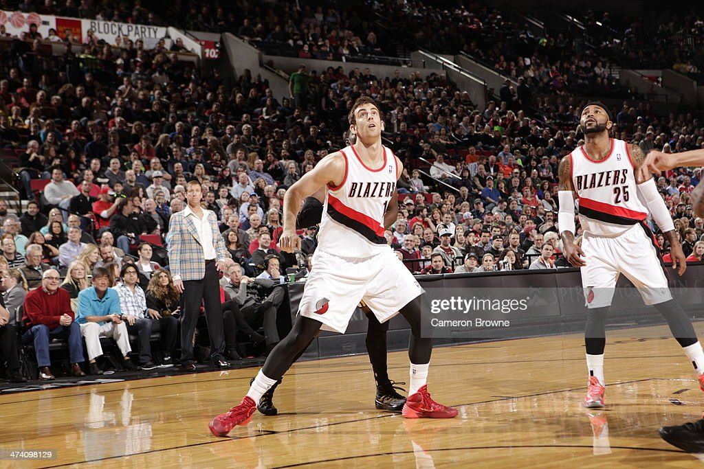 <a gi-track='captionPersonalityLinkClicked' href=/galleries/search?phrase=Joel+Freeland&family=editorial&specificpeople=757235 ng-click='$event.stopPropagation()'>Joel Freeland</a> #19 of the Portland Trailblazers looks up for the rebound against the Utah Jazz on February 21, 2014 at the Moda Center Arena in Portland, Oregon.