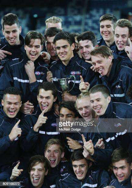 Joel Garner of Vic Metro celebrates winning the competition with teammates during the U18 AFL Championships match between Vic Metro and the Allies at...