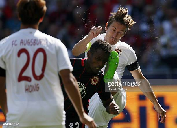 Joel Gerezgiher of Frankfurt and Paul Verhaegh of Augsburg compete for the ball during the Bundesliga match between Eintracht Frankfurt and FC...