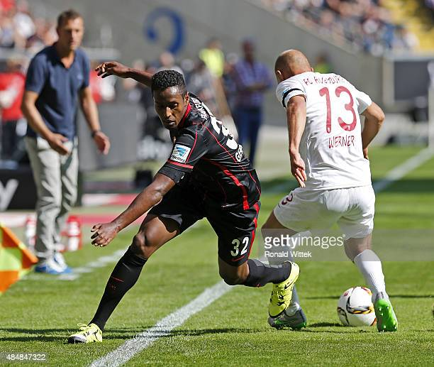 Joel Gerezgiher of Frankfurt and Tobias Werner of Augsburg compete for the ball during the Bundesliga match between Eintracht Frankfurt and FC...