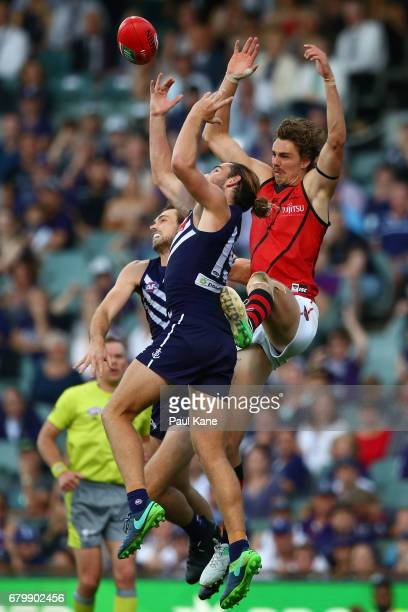 Joel Hamling and Connor Blakely of the Dockers contest a mark against Joe Daniher of the Bombers during the round seven AFL match between the...