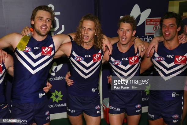Joel Hamling Nathan Fyfe Lee Spurr and Brady Grey of the Dockers sing the club song after winning the round seven AFL match between the Fremantle...