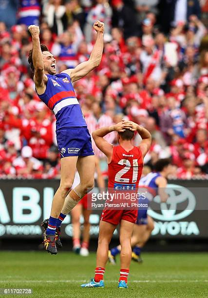 Joel Hamling of the Bulldogs celebrates victory on the siren during the 2016 Toyota AFL Grand Final match between the Sydney Swans and the Western...