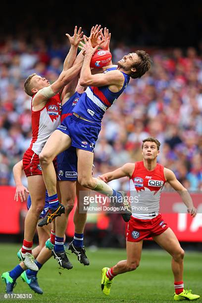 Joel Hamling of the Bulldogs marks the ball against Daniel Hannebery of the Swans during the 2016 AFL Grand Final match between the Sydney Swans and...