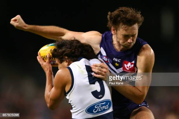 Joel Hamling of the Dockers attempts to spoil the mark for Nakia Cockatoo of the Cats during the round one AFL match between the Fremantle Dockers...