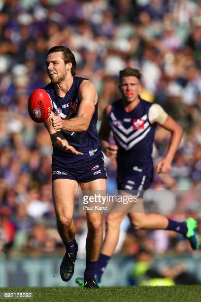 Joel Hamling of the Dockers handballs during the round 11 AFL match between the Fremantle Dockers and the Collingwood Magpies at Domain Stadium on...