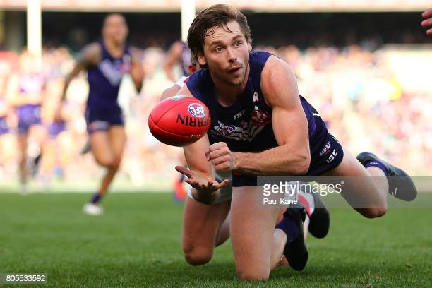 Joel Hamling of the Dockers handballs during the round 15 AFL match between the Fremantle Dockers and the St Kilda Saints at Domain Stadium on July 2...