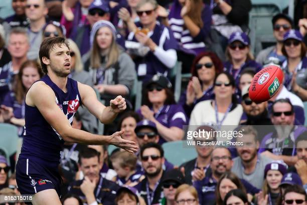 Joel Hamling of the Dockers handpasses the ball during the round 17 AFL match between the Fremantle Dockers and the West Coast Eagles at Domain...