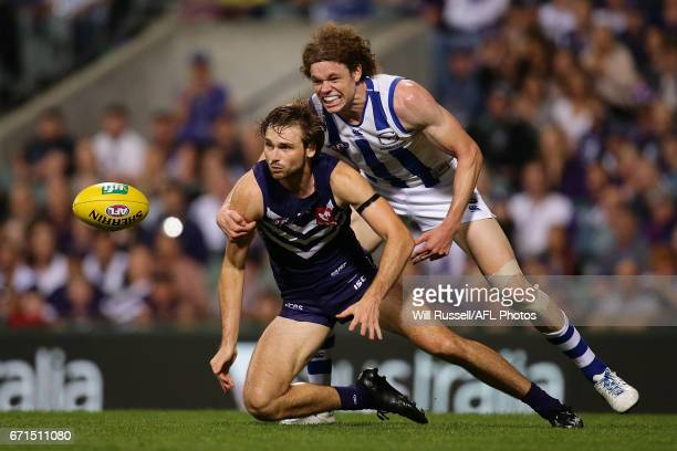 Joel Hamling of the Dockers is tackled by Ben Brown of the Kangaroos during the round five AFL match between the Fremantle Dockers and the North...