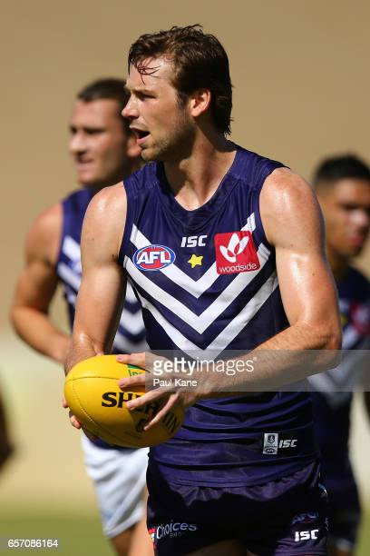 Joel Hamling of the Dockers looks to pass the ball during a Fremantle Dockers AFL training session at Victor George Kailis Oval on March 24 2017 in...