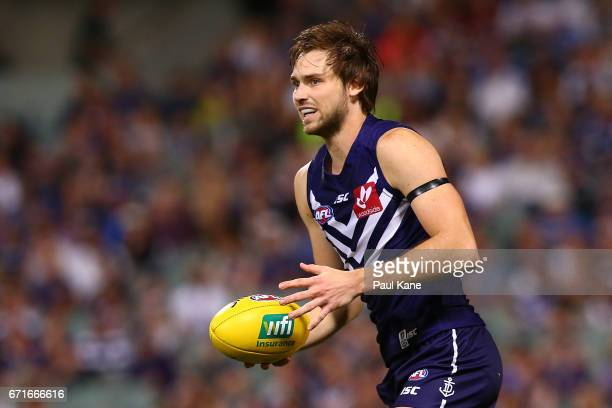 Joel Hamling of the Dockers looks to pass the ball during the round five AFL match between the Fremantle Dockers and the North Melbourne Kangaroos at...