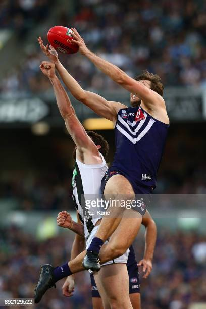 Joel Hamling of the Dockers marks the ball against Tyson Goldsack of the Magpies during the round 11 AFL match between the Fremantle Dockers and the...