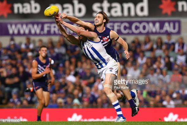 Joel Hamling of the Dockers spoils the mark for Ben Brown of the Kangaroos during the round five AFL match between the Fremantle Dockers and the...