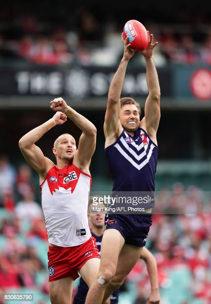 Joel Hamling of the Dockers takes a mark in front of Sam Reid of the Swans during the round 21 AFL match between the Sydney Swans and the Fremantle...