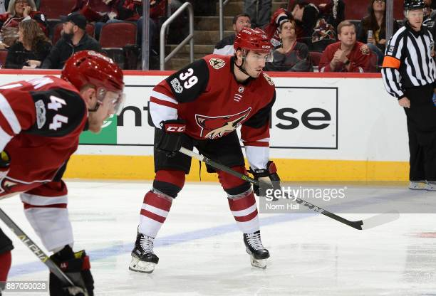 Joel Hanley of the Arizona Coyotes gets ready during a faceoff against the New Jersey Devils at Gila River Arena on December 2 2017 in Glendale...