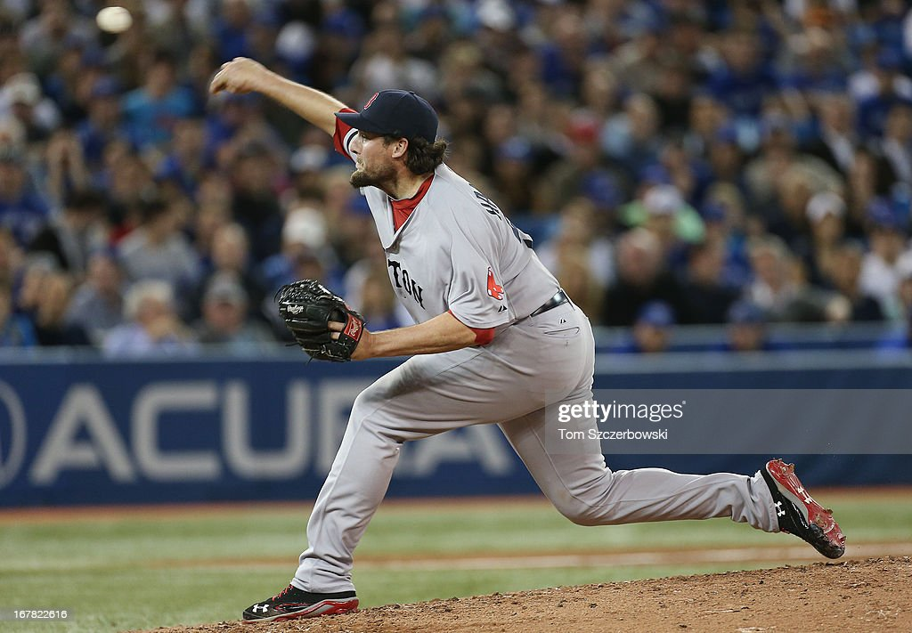 Joel Hanrahan of the Boston Red Sox delivers a pitch during MLB game action against the Toronto Blue Jays on April 30 2013 at Rogers Centre in...