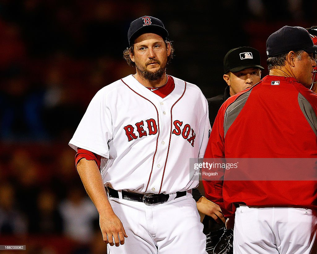 Joel Hanrahan #52 of the Boston Red Sox leaves in the 9th inning after giving up a game-tying home run against the Minnesota Twins on May 6, 2013 in Boston, Massachusetts.