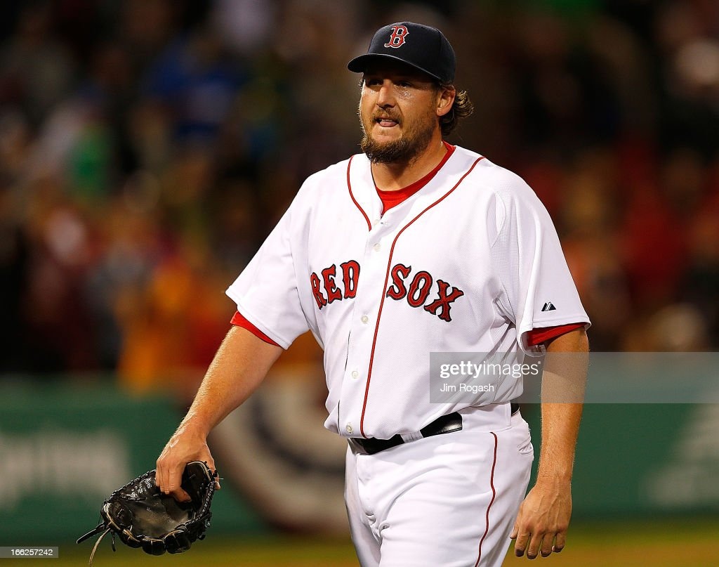 Joel Hanrahan of the Boston Red Sox leaves the game after giving up a threerun home run to Manny Machado of the Baltimore Orioles in the ninth inning...