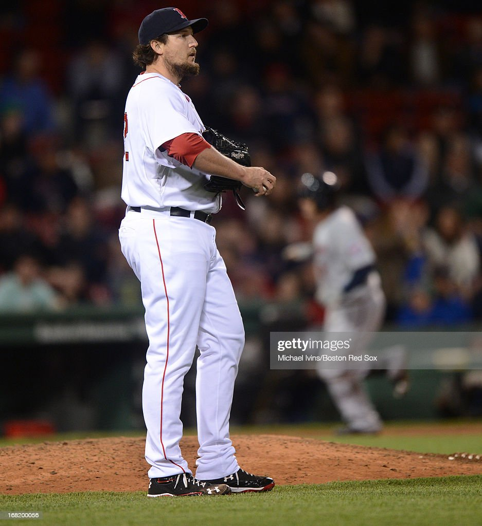 Joel Hanrahan #52 of the Boston Red Sox looks up towards the scoreboard after allowing a home run to Brian Dozier #2 of the Minnesota Twins in the ninth inning on May 6, 2013 at Fenway Park in Boston, Massachusetts.