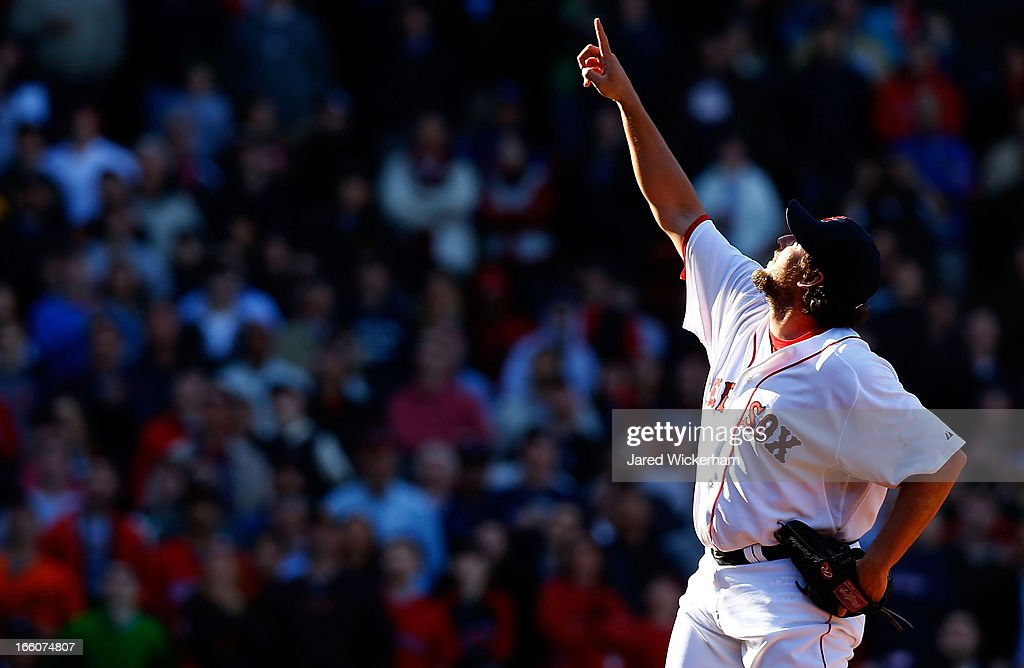 Joel Hanrahan of the Boston Red Sox signals for a fly ball in the ninth inning for the final out against the Baltimore Orioles during the Opening Day...