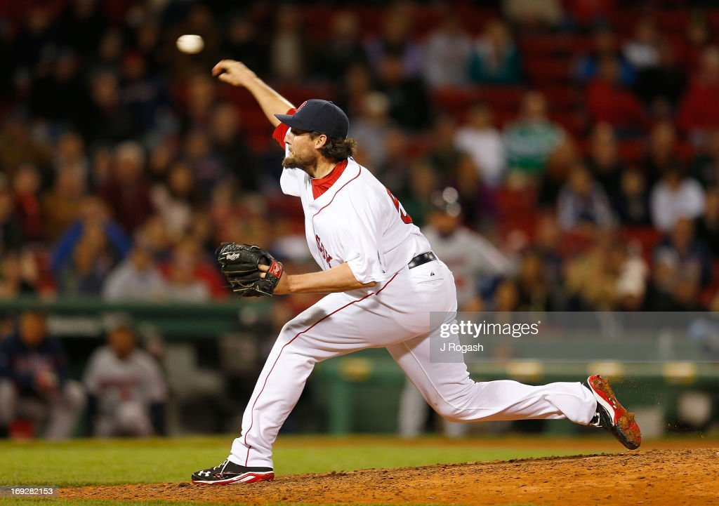 Joel Hanrahan of the Boston Red Sox throws against the Minnesota Twins at Fenway Park on May 6 2013 in Boston Massachusetts Drew was tagged out on...