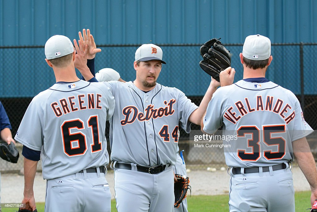Joel Hanrahan of the Detroit Tigers gets highfives from teammates Shane Greene and Justin Verlander after winning the annual rag ball competition...