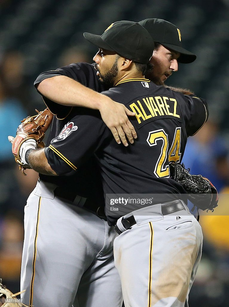 <a gi-track='captionPersonalityLinkClicked' href=/galleries/search?phrase=Joel+Hanrahan&family=editorial&specificpeople=2527864 ng-click='$event.stopPropagation()'>Joel Hanrahan</a> #52 of the Pittsburgh Pirates celebrates the win over the New York Mets with teammate Pedro Alvarez #24 after the game on September 25, 2012 at Citi Field in the Flushing neighborhood of the Queens borough of New York City.The Pittsburgh Pirates defeated the New York Mets 10-6.